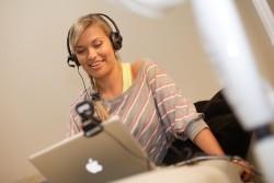 Skype_headset_on_woman-250x167